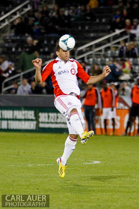 May 4th, 2013 - Toronto FC midfielder Darel Russell (16) heads the ball in the second half of the MLS match between the Toronto FC and the Colorado Rapids at Dick's Sporting Goods Park in Commerce City, CO
