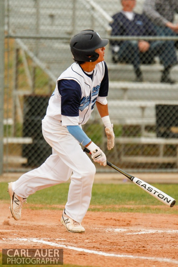 April 30th, 2013: Ralston Valley Mustangs junior Jacob Gallegos (27) watches the ball sail over the fence for a home run in the game against the Columbine Rebels at Ralston Valley High School