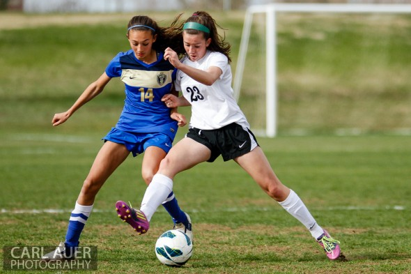 April 29th, 2013:  Wheat Ridge Farmers freshman midfielder Frankee Broer (14) and D'Evelyn Jaguars freshman Aubrey Sotolongo (23) battle for control of the ball in the game at the North Area Athletic Complex in Arvada, Colorado