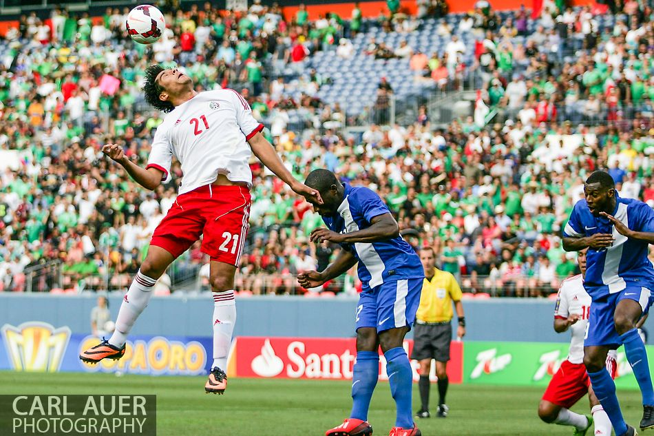 July 14 2013:  Mexico Forward Javier Orozco (21) attempts a head shot off of a Mexico corner kick late in the second half of the CONCACAF Gold Cup soccer match between Martinique and Mexico at Sports Authority Field in Denver, CO. USA.