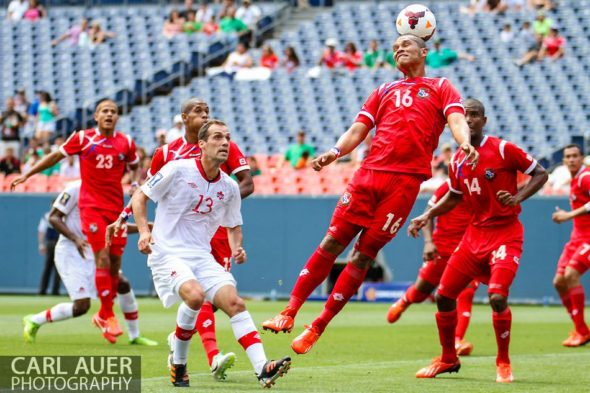 July 14 2013:  Panama Forward Rolando Blackburn (16) breaks up a Canada corner kick in the first half of the CONCACAF Gold Cup soccer match between Panama and Canada at Sports Authority Field in Denver, CO. USA.