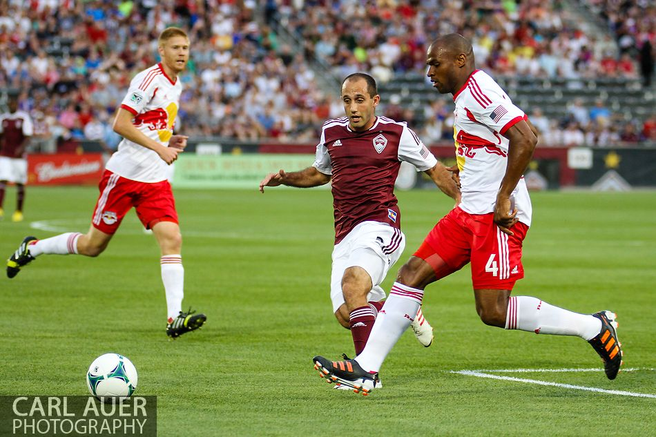 July 4th, 2013 - Colorado Rapids midfielder Nick LaBrocca (2) and New York Red Bulls defender Jamison Olave (4) go after the ball early in the first half of action in the Major League Soccer match between New York Red Bulls and the Colorado Rapids at Dick's Sporting Goods Park in Commerce City, CO