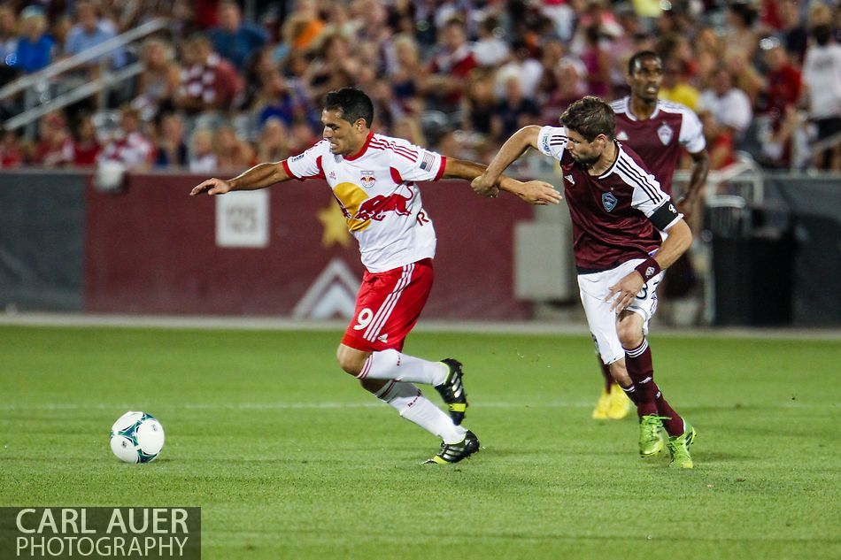 July 4th, 2013 - New York Red Bulls forward Fabian Espindola (9) pulls away from Colorado Rapids defender Drew Moor (3) in the second half of the Major League Soccer match between New York Red Bulls and the Colorado Rapids at Dick's Sporting Goods Park in Commerce City, CO