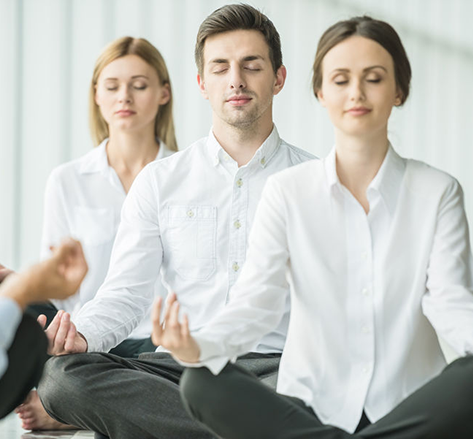 picture of people at work doing yoga