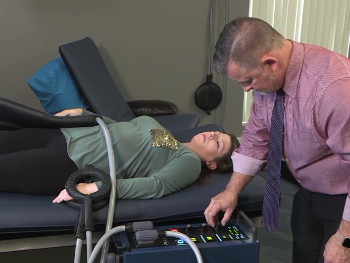 Dr. Tracy Standridge applying PEMF to a patient.