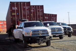 Used shipping container delivery fleet of trucks