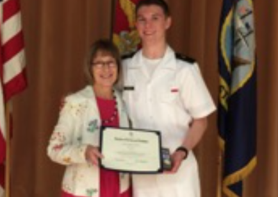 The 2016 NU NROTC top Midshipman is awarded a DAR medal.