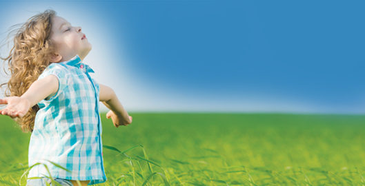 common image of a child breathing clean air used frequently in the ecogard clean air marketing campaign