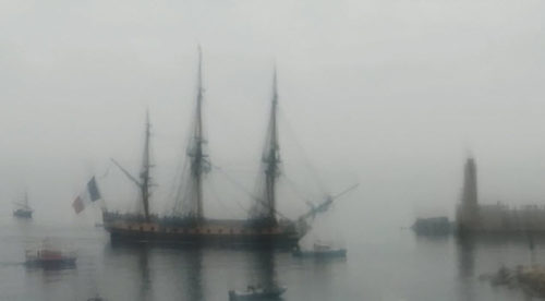 Arrival of the French frigate Hermione into foggy Nice Port.