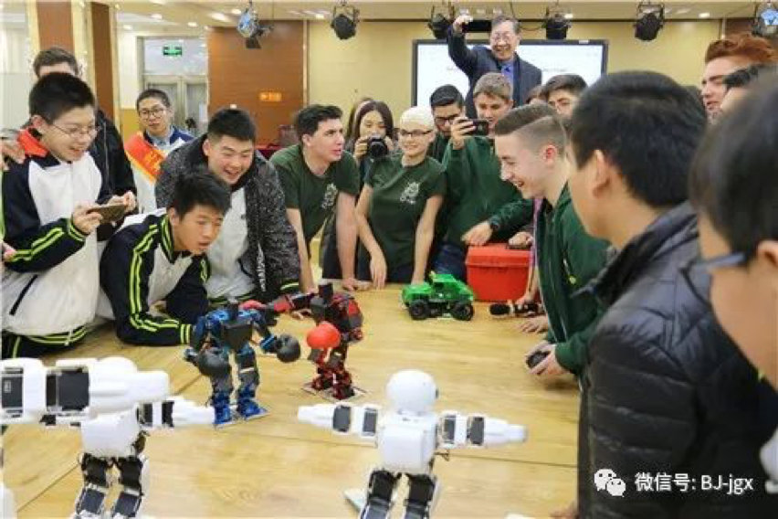 Chinese and American Students Competing in a Robot Boxing Match