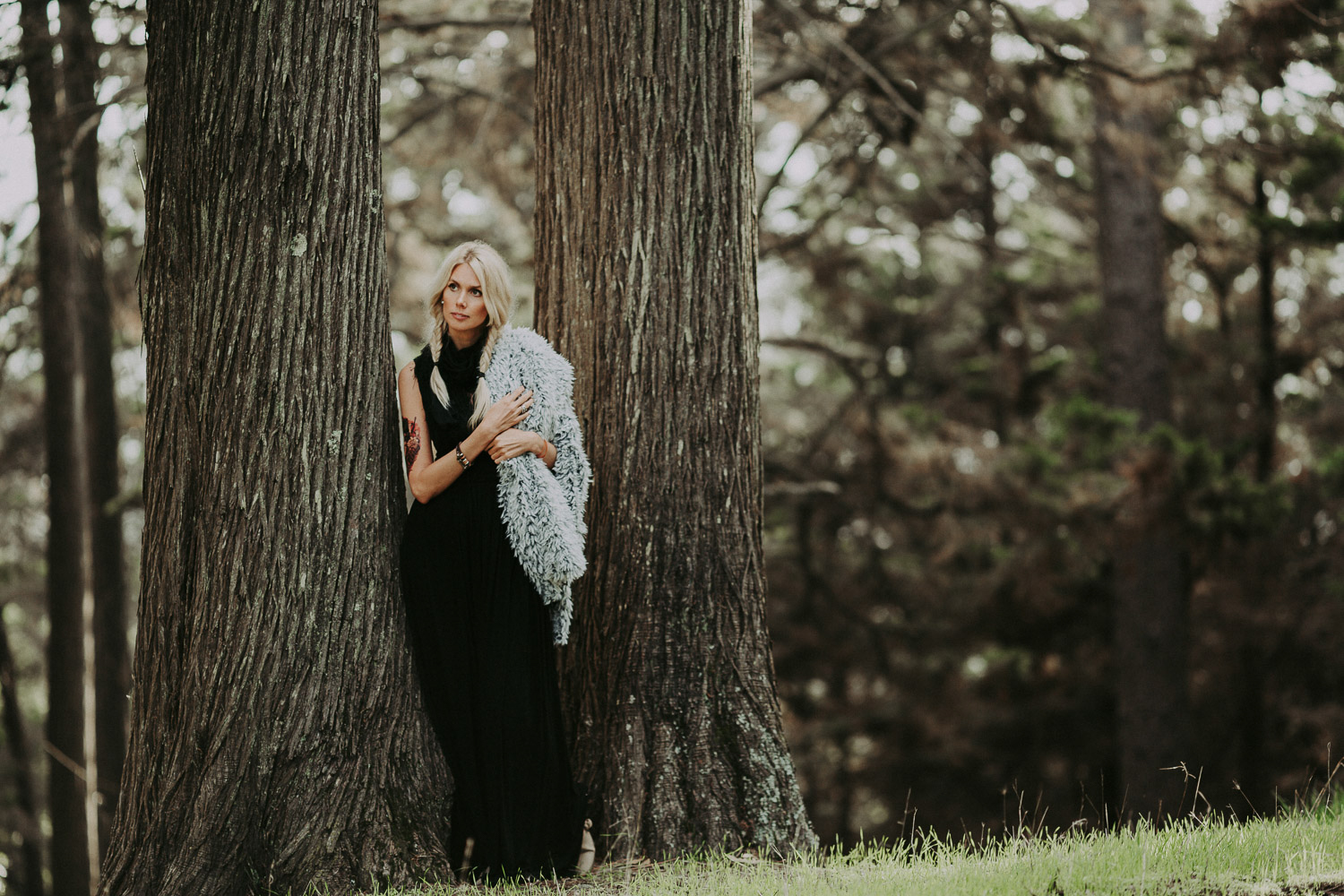 Image of a girl stands next to the tree