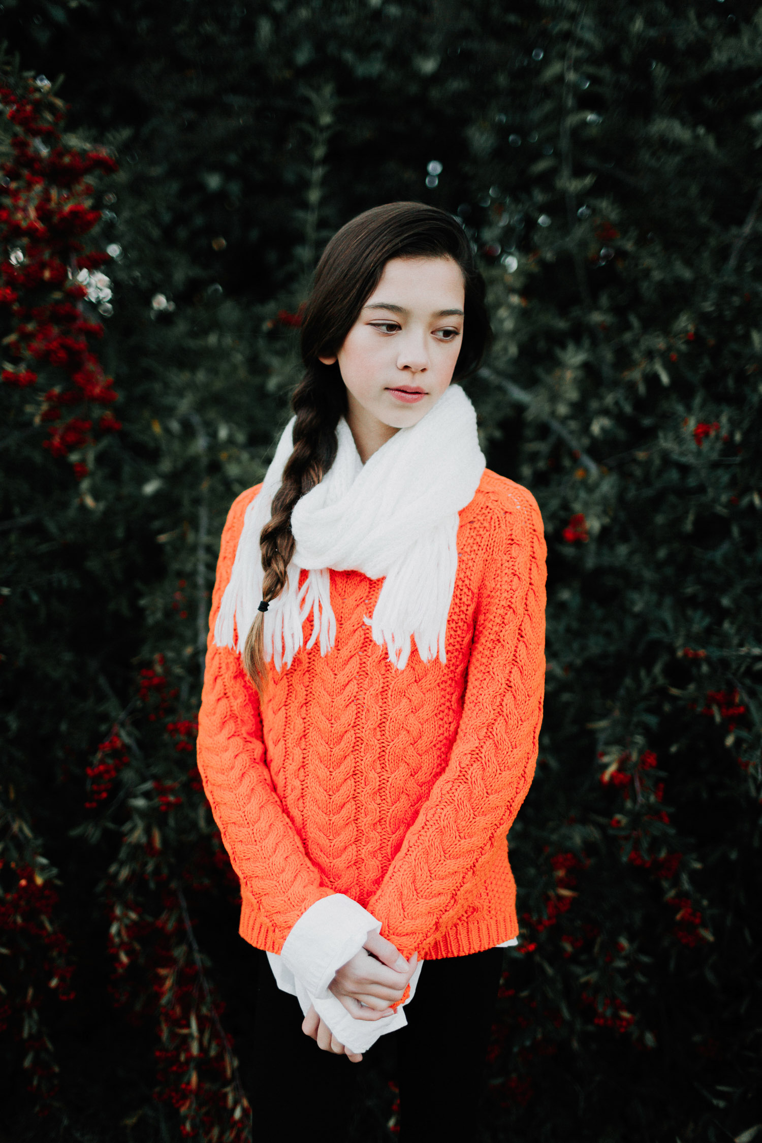 Image of orange sweater girl looking to the right