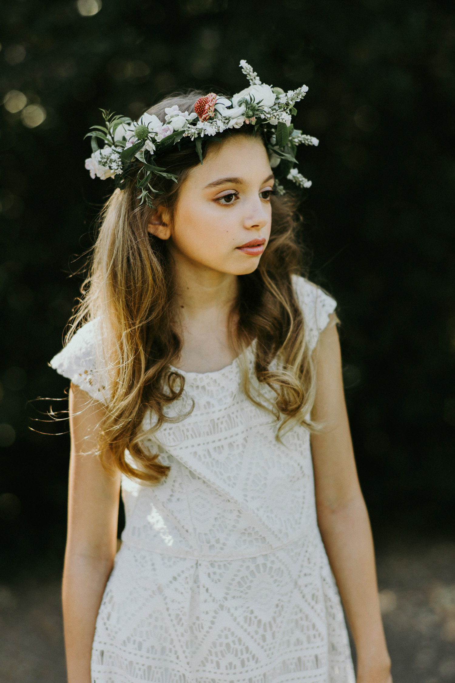 Image of a white dress girl wearing a flower crown