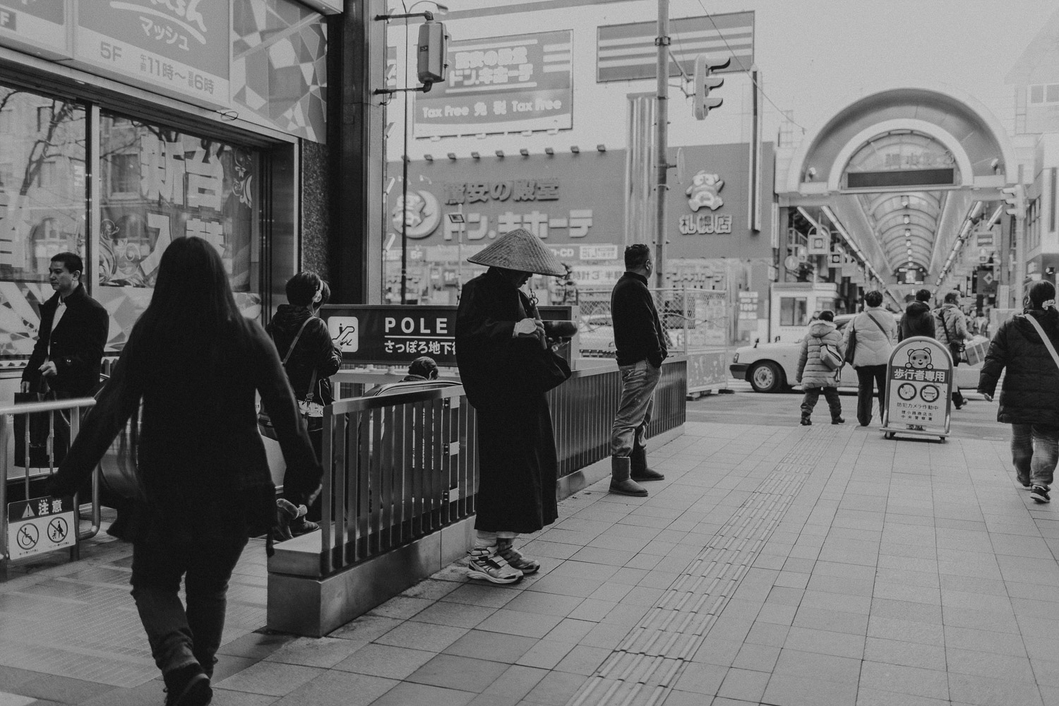 Black and White image of Japanese monk in shopping district