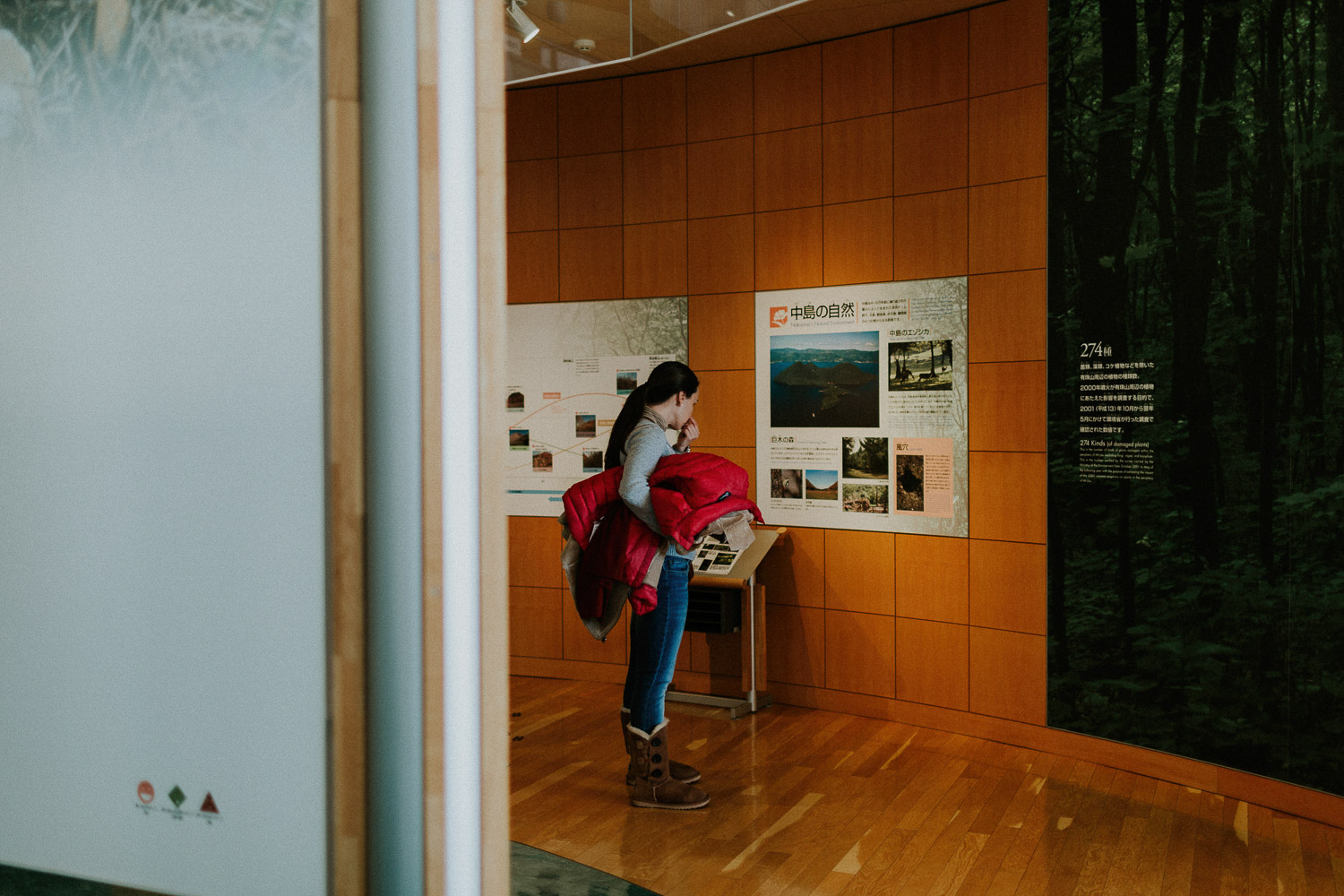 Image of a girl reading inside museum