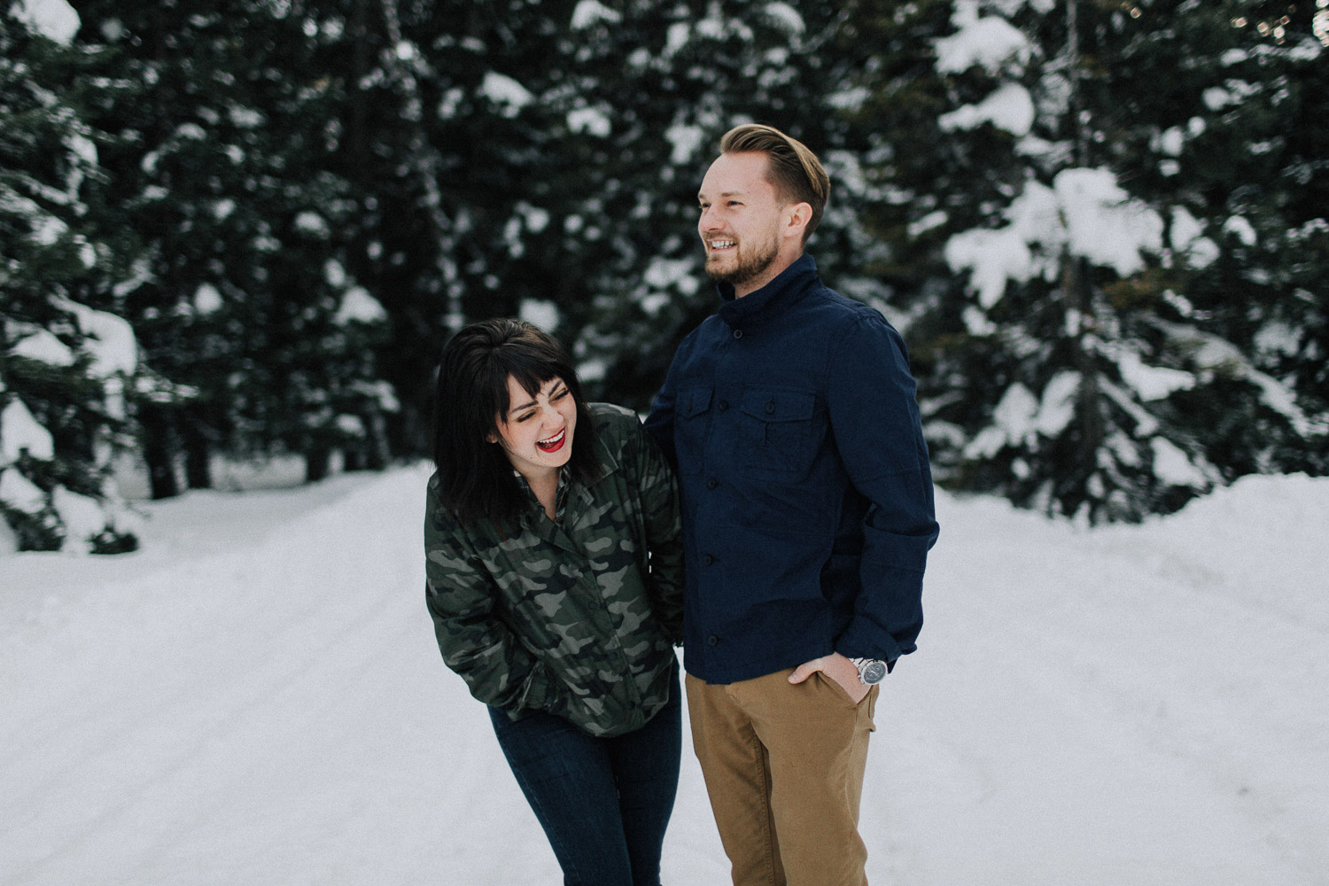 Image of couple laugh tougher in snow