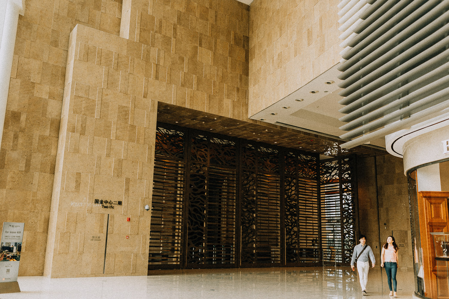 Image of two people walking inside the shopping mall