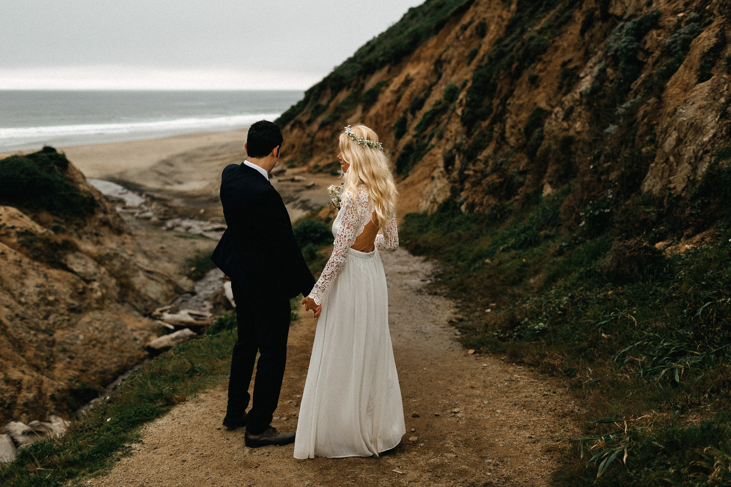 Image of bride holds hands with groom