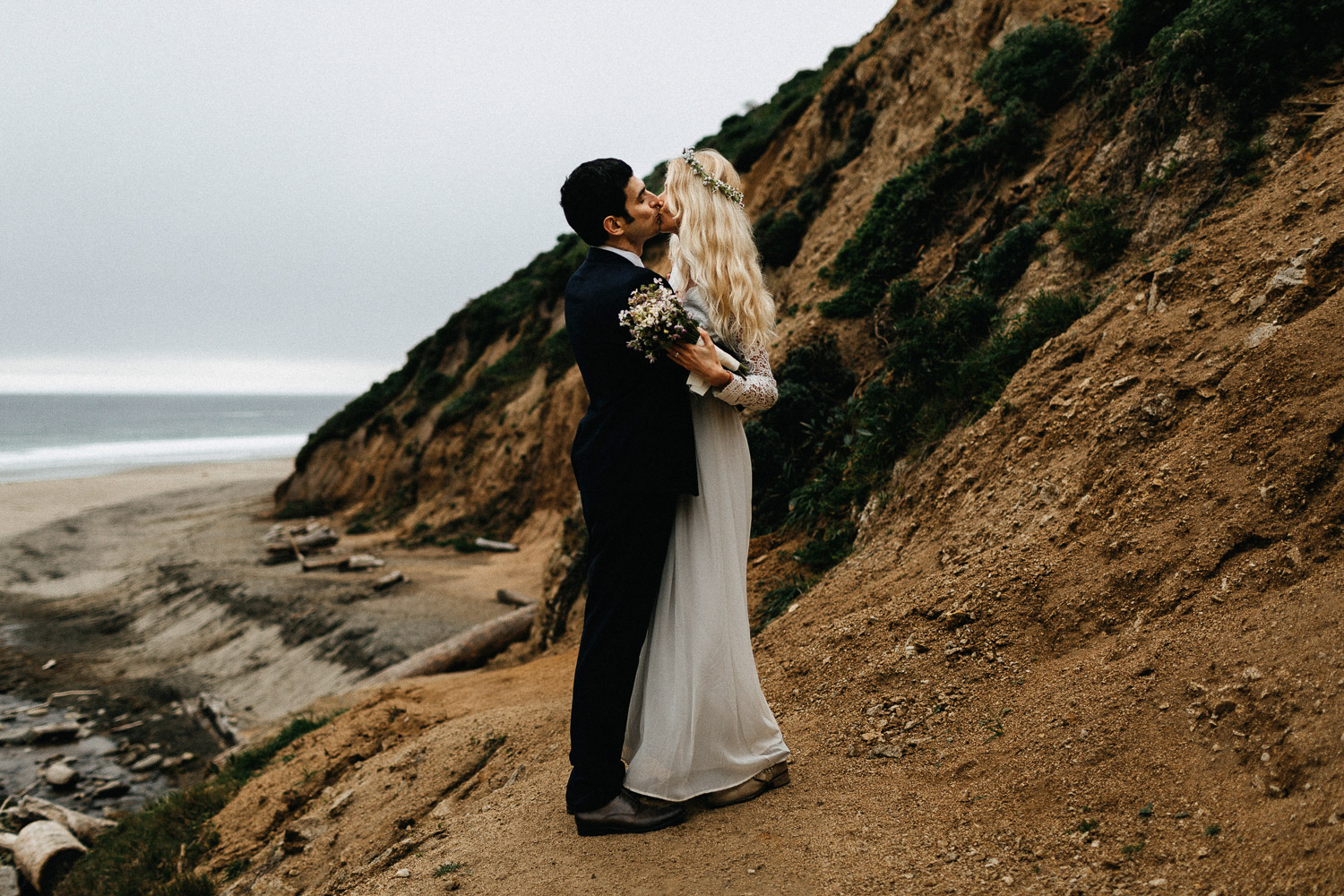 Image of groom and bride kiss each other