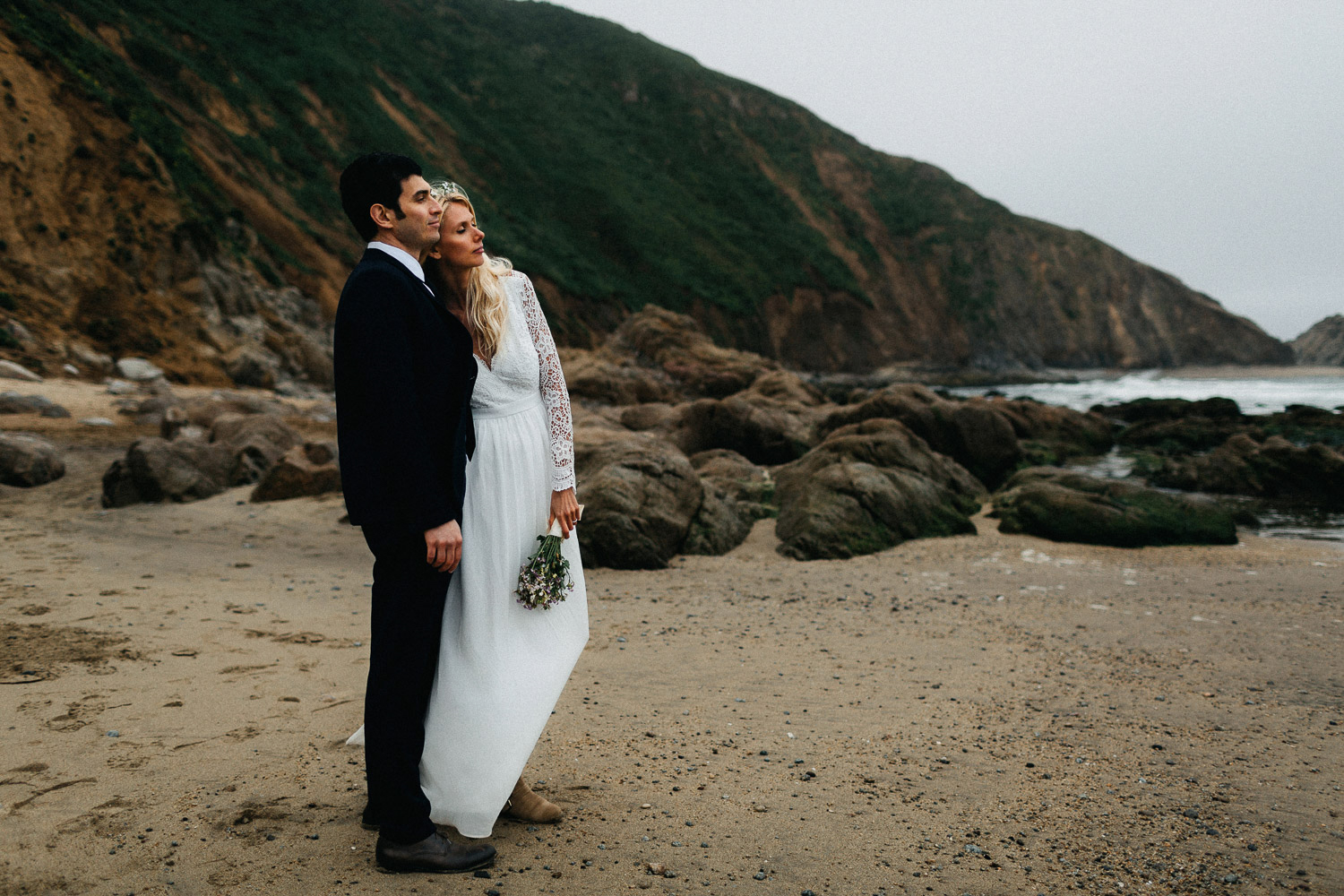 Image of bride and groom look forward together
