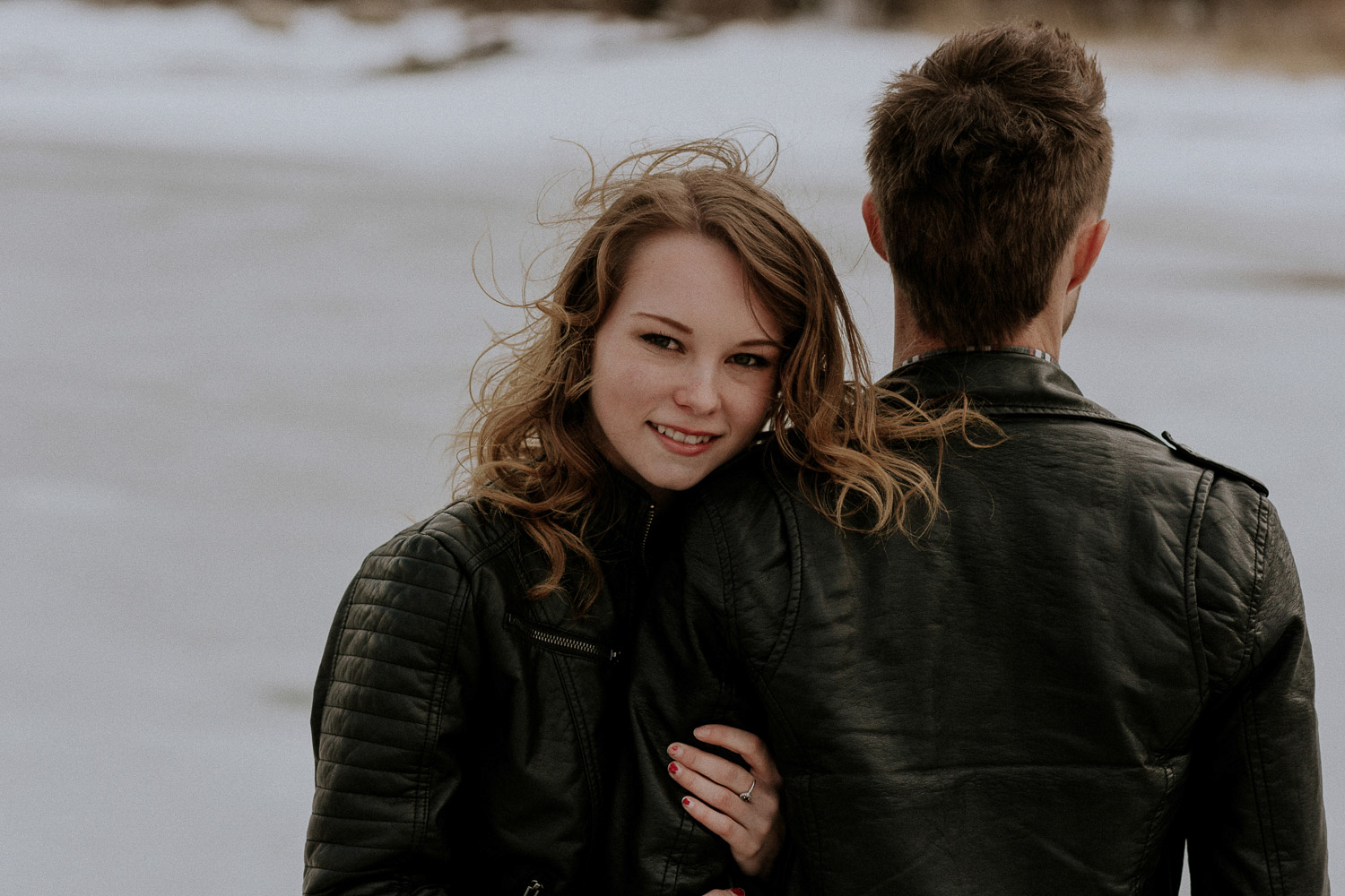 Image of girl holds guy's one arm