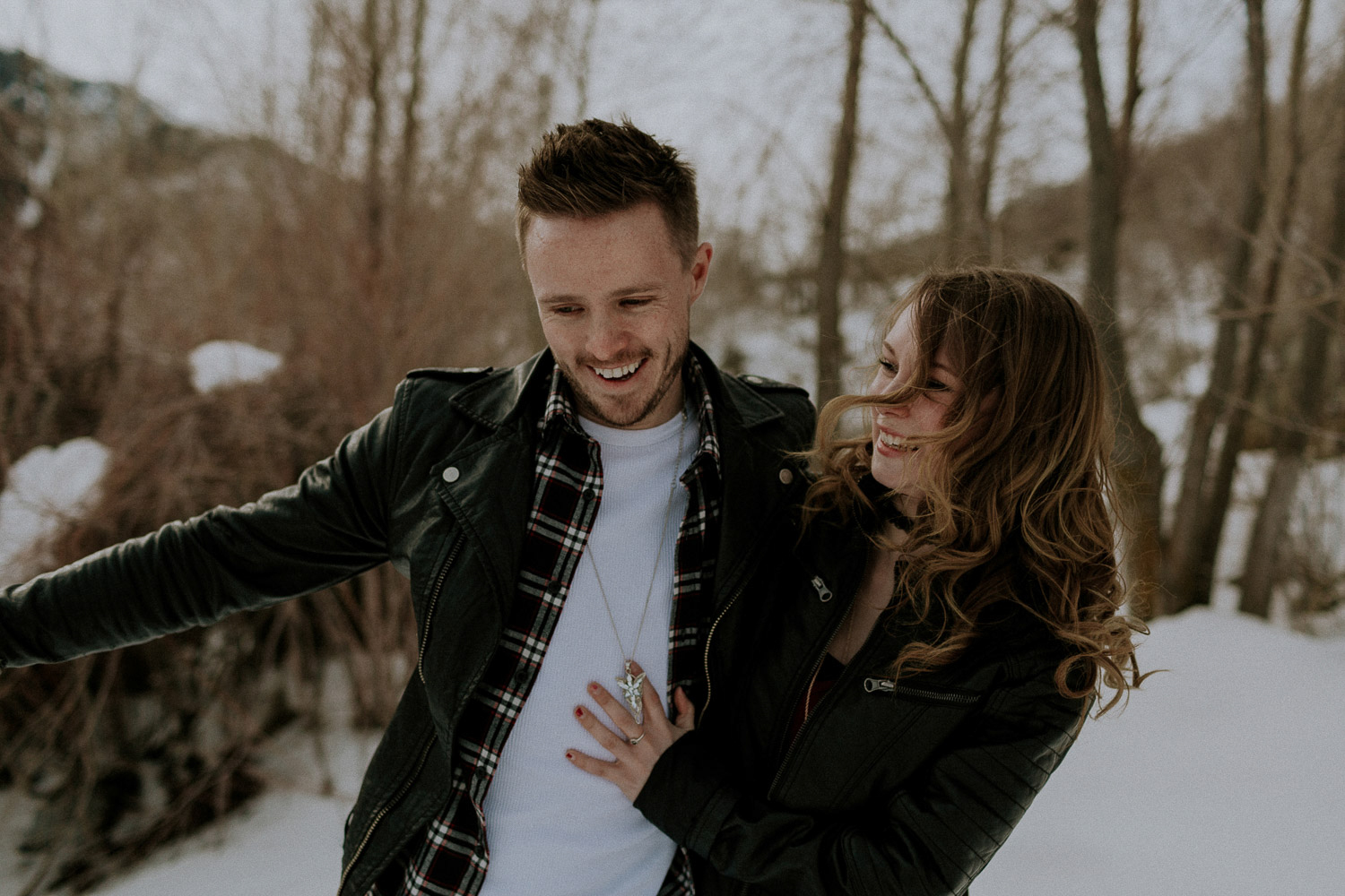 Image of couple laugh together