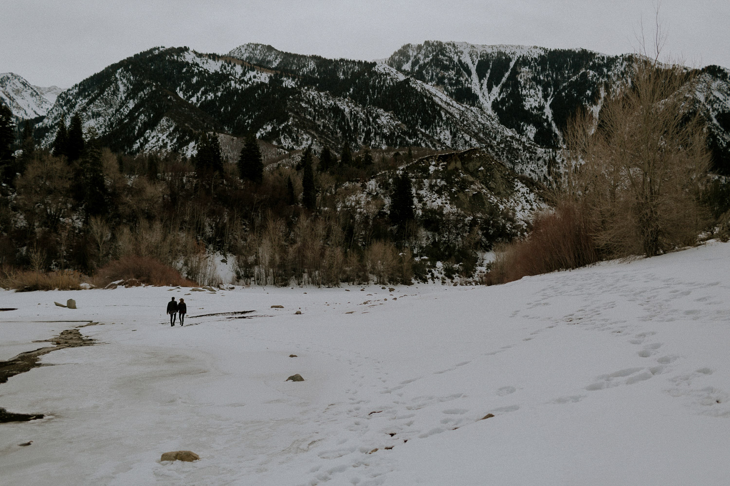 Image of couple walk together in snow