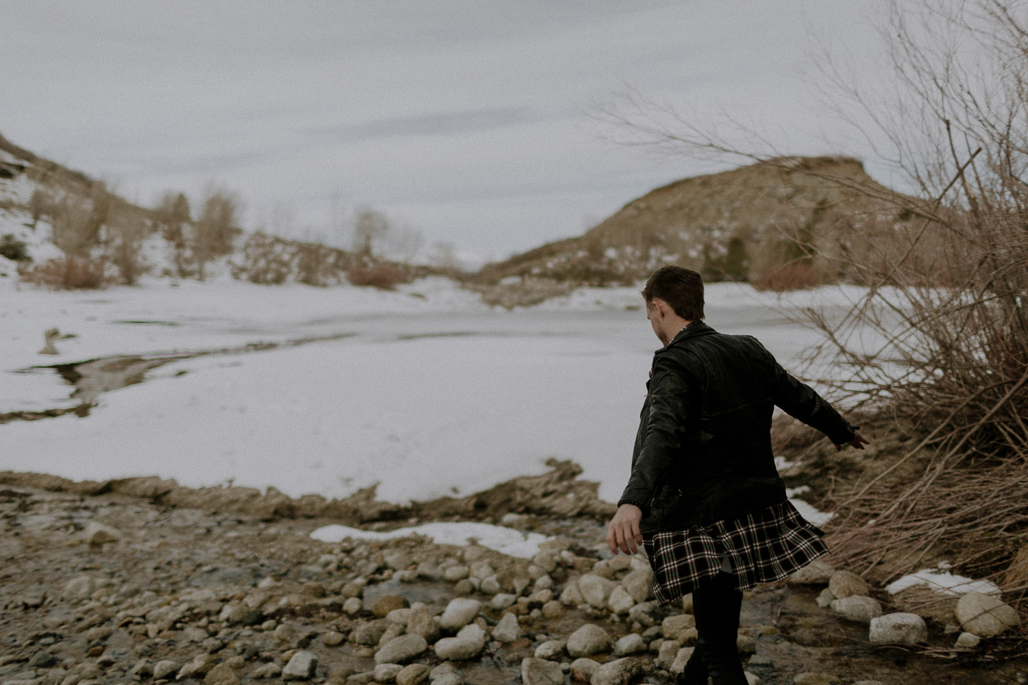 Image of guy in front of yellow hills and white snow