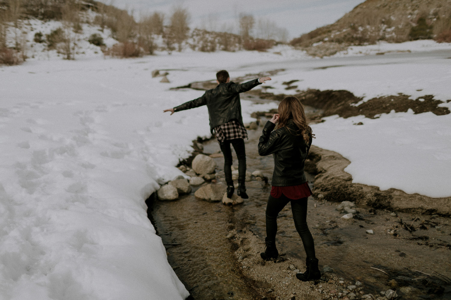 Image of girl follows guy and walks between snow