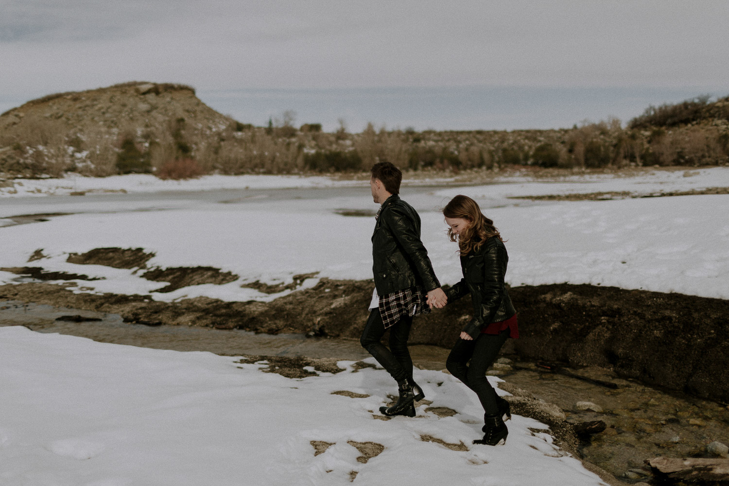 Image of couple hold hands together and walk on snow