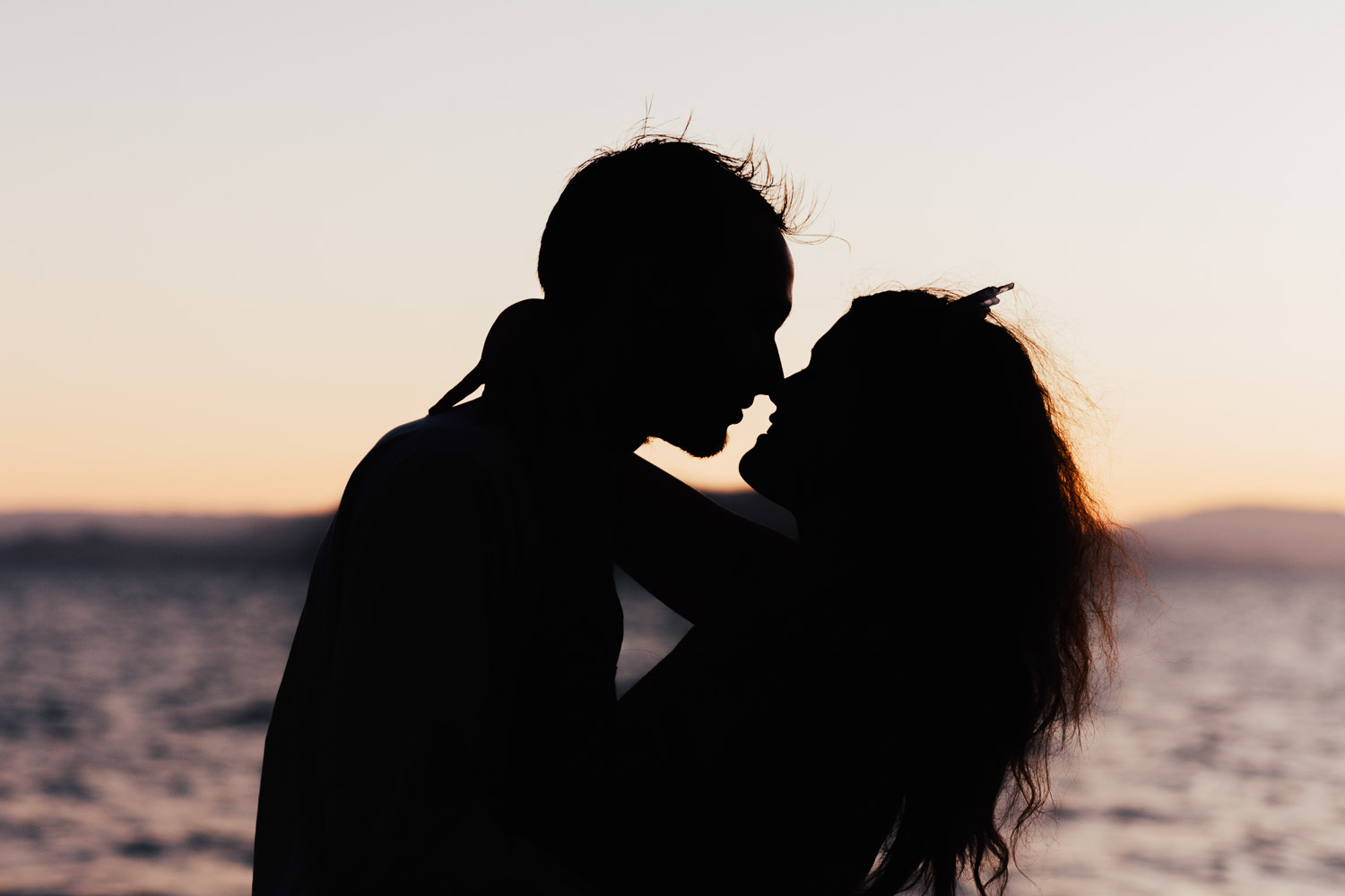 Image of groom and bride silhouette kiss