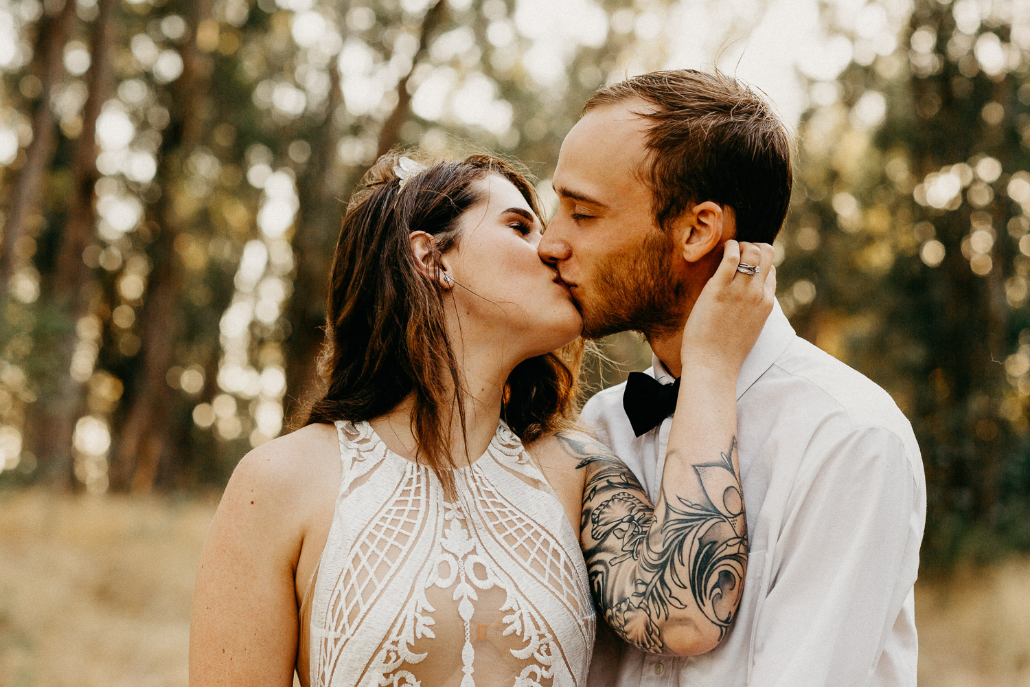 Image of bride and groom kiss each other