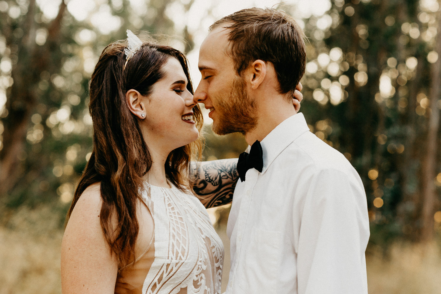 Image of bride and groom have nose touches