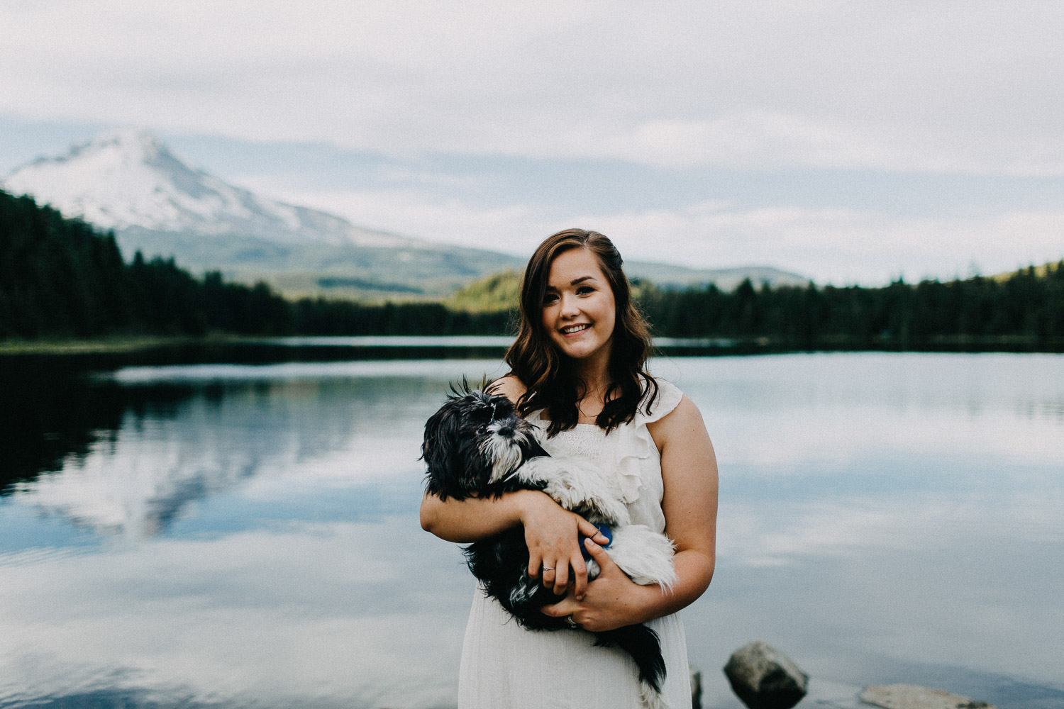 Image of girl holds her dog in front of Mt Hood