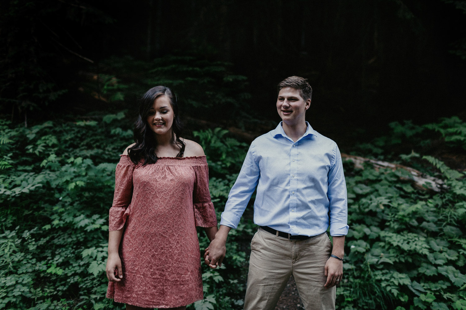 Image of couple hold hands together