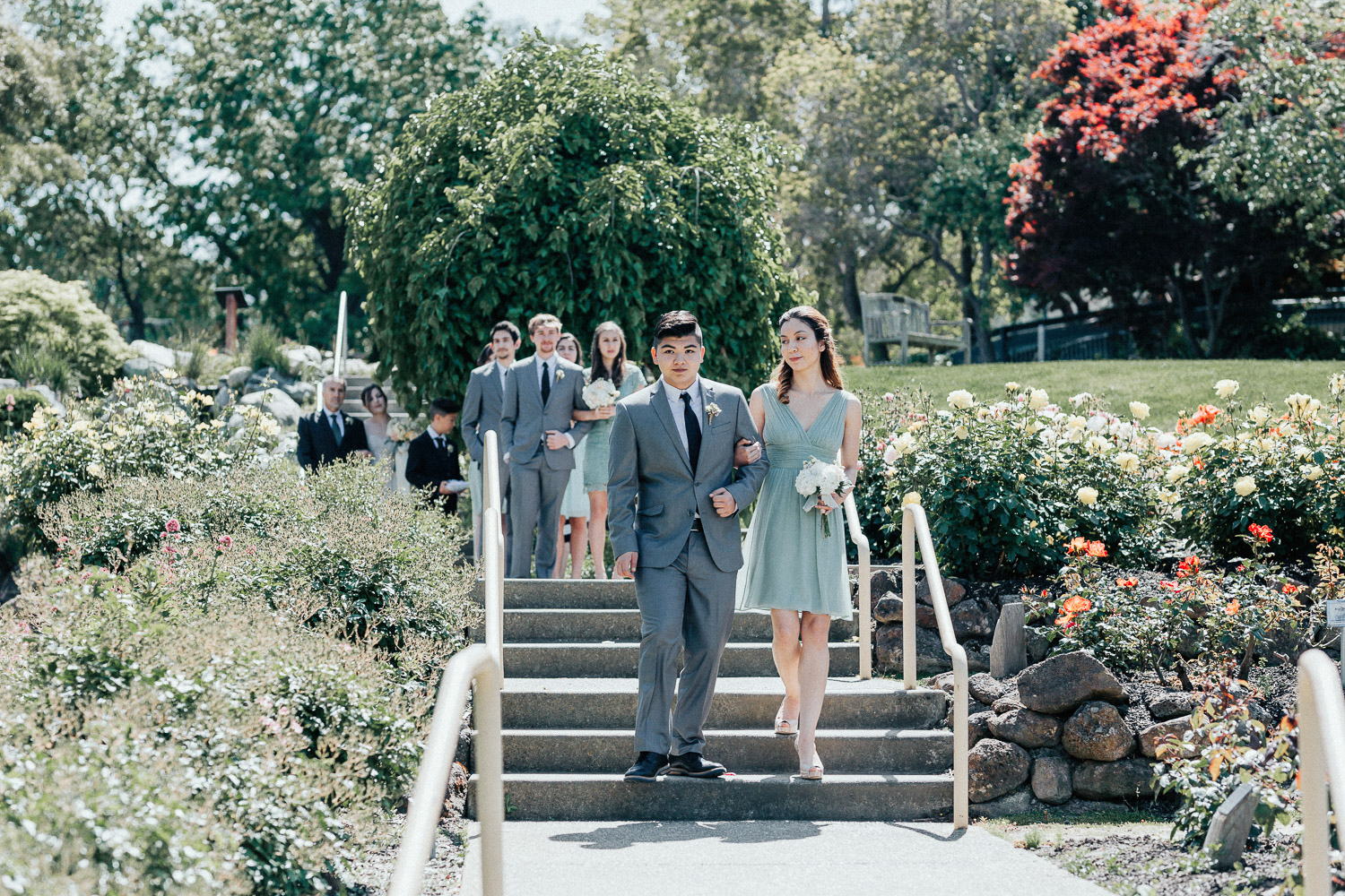 Image of bridesmaid and groomsman walk down the aisle