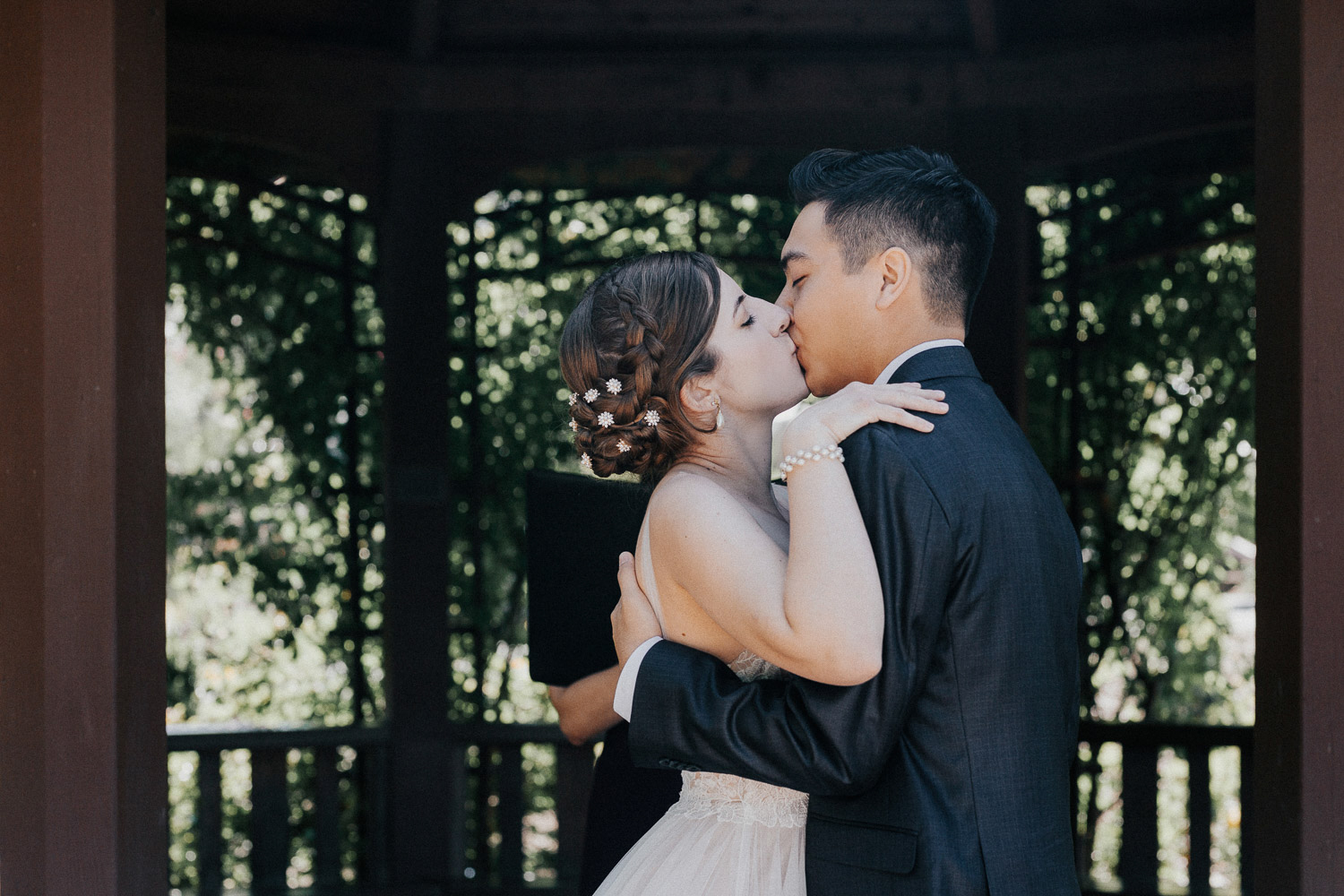 Image of bride and groom kiss each other on ceremony