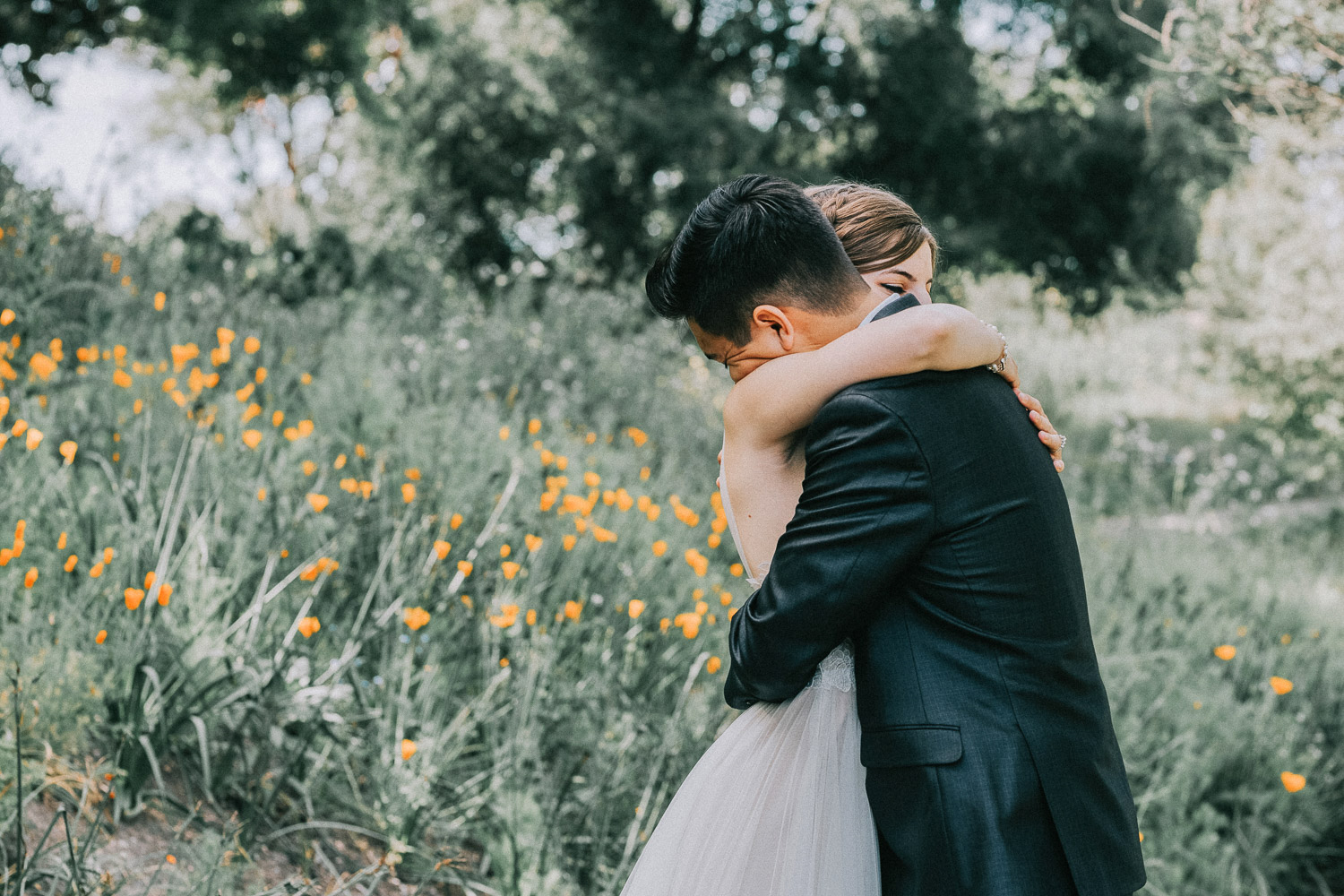 Image of groom hugs bride
