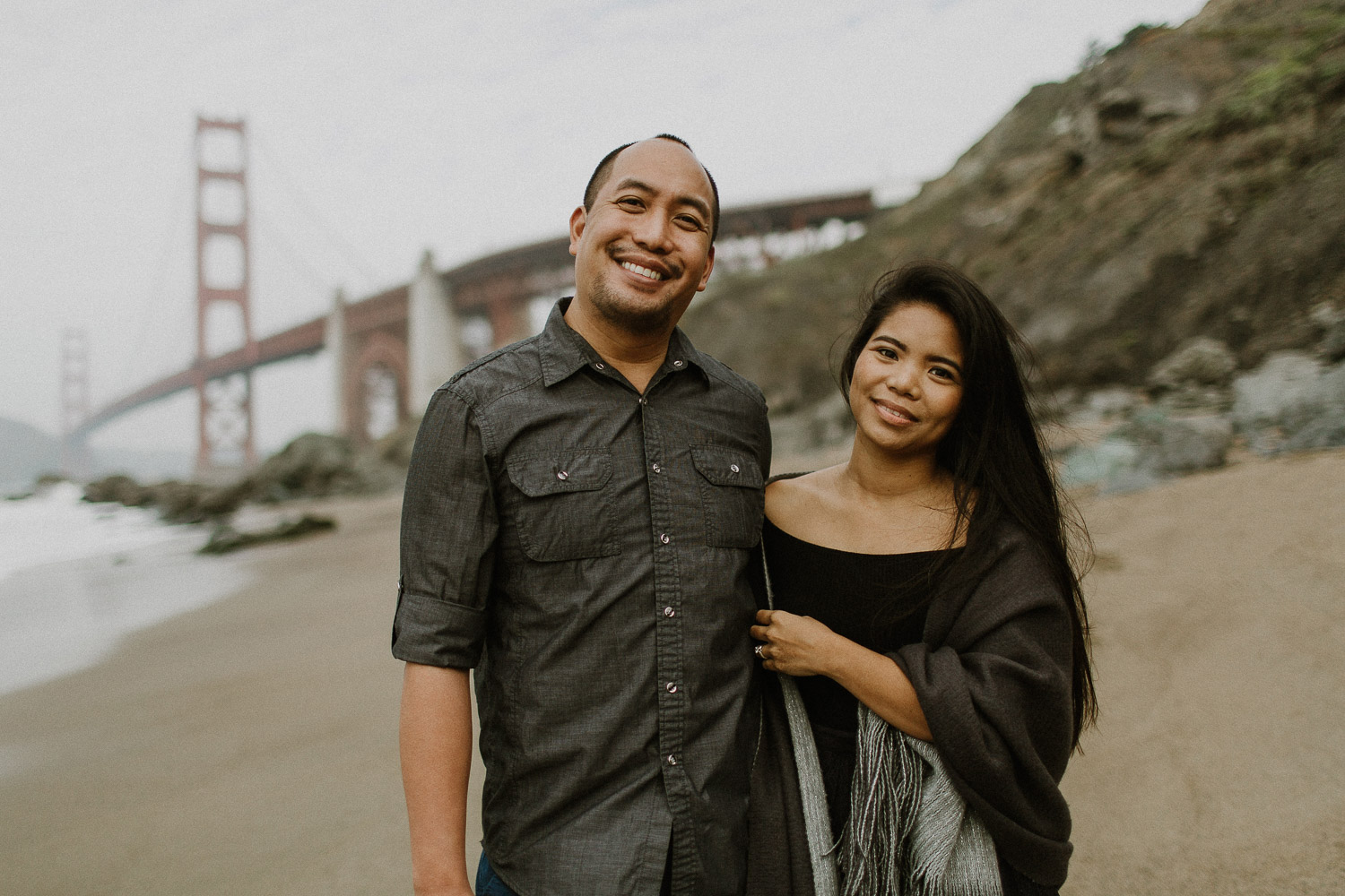Image of Asian Couple Smiles Together on the Beach