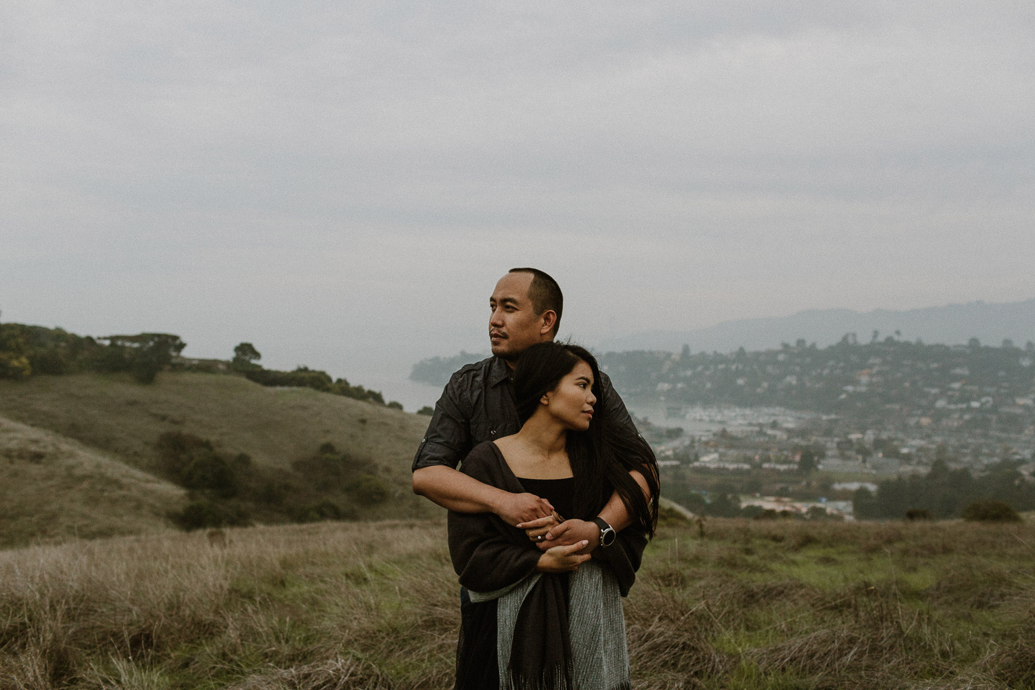 Image of Asian Couple Holds Each Other and Stands on the Hill