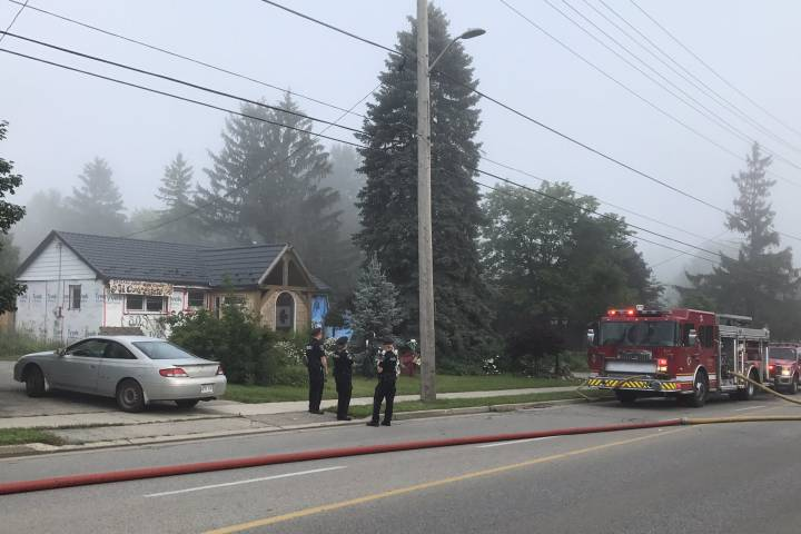 Police look on during house fire