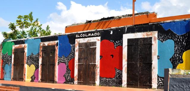 Leo Díaz finaliza en Sosúa mural histórico 'El Colmado'.