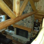 Looking down from loft, great room stone fireplace