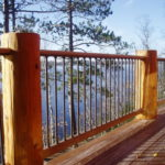 Ipe decking and railing with log posts and aluminum ballisters