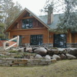 Cedar and stone small cabin, flat stone landscaping