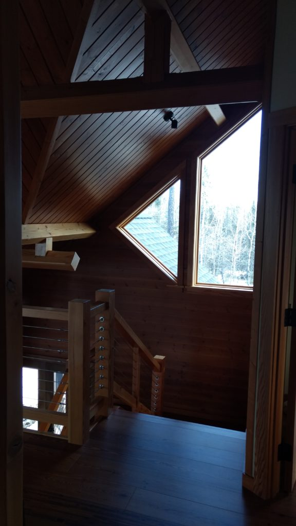 Overlooking timber stairs from loft