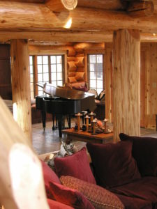 Looking accros the log home at the piano room