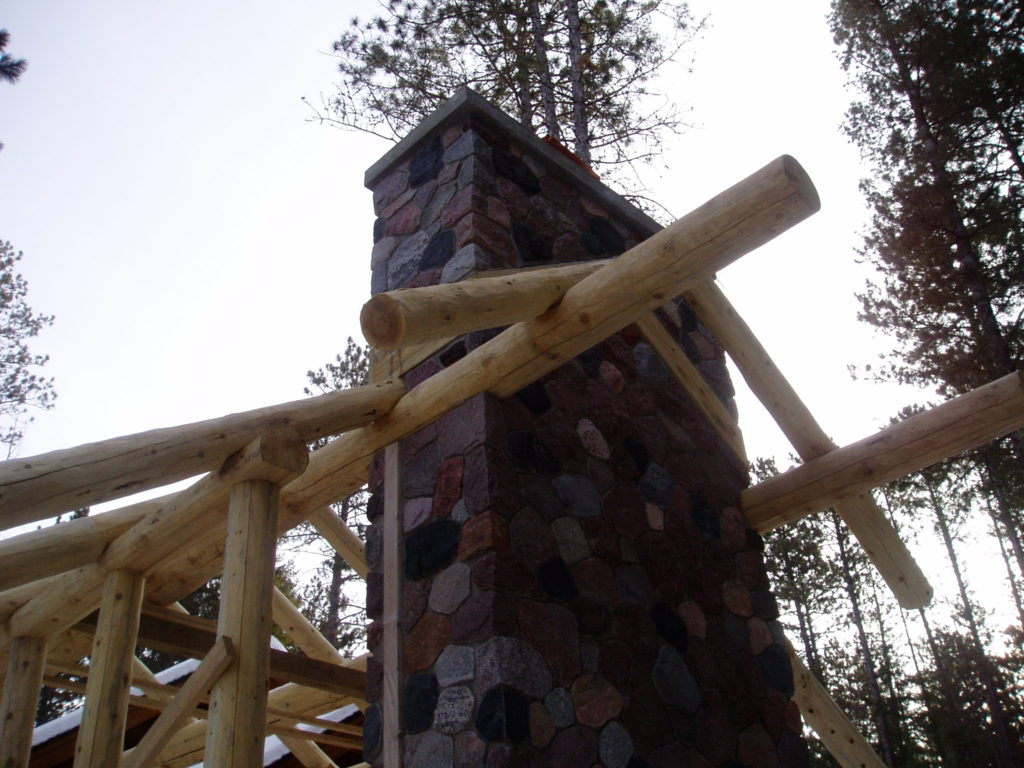 Perlins and rock fireplace, gazebo under construction