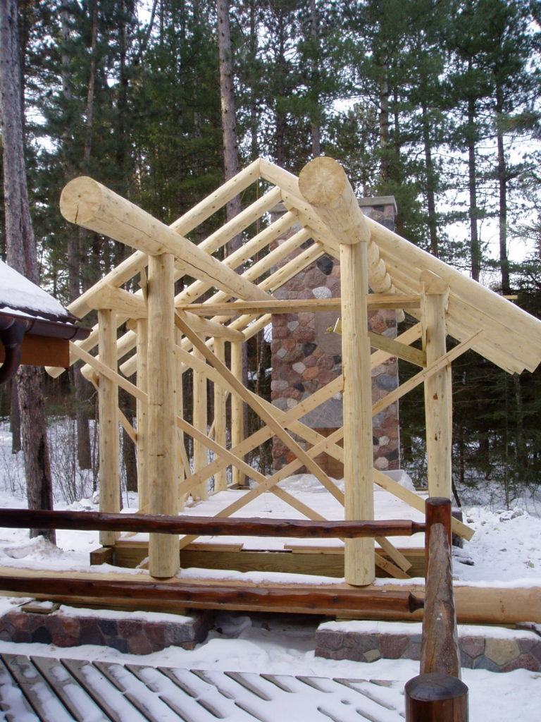 Log posts, perlins and rafters, custom log gazebo in progress