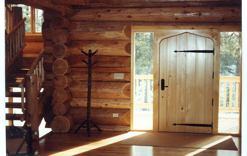 Custom entry door, log home